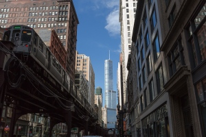 """CTA's Elevated """"L"""" Train with the Trump Tower in the background."""